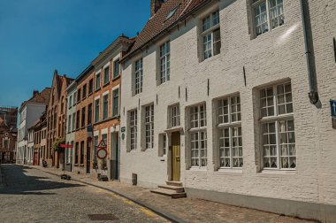 Houses in typical Flanders style on street of Bruges