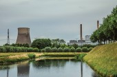Canal with gardens and nuclear power plant in Geertruidenberg