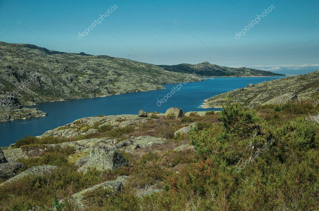Hilly landscape with lake on highlands