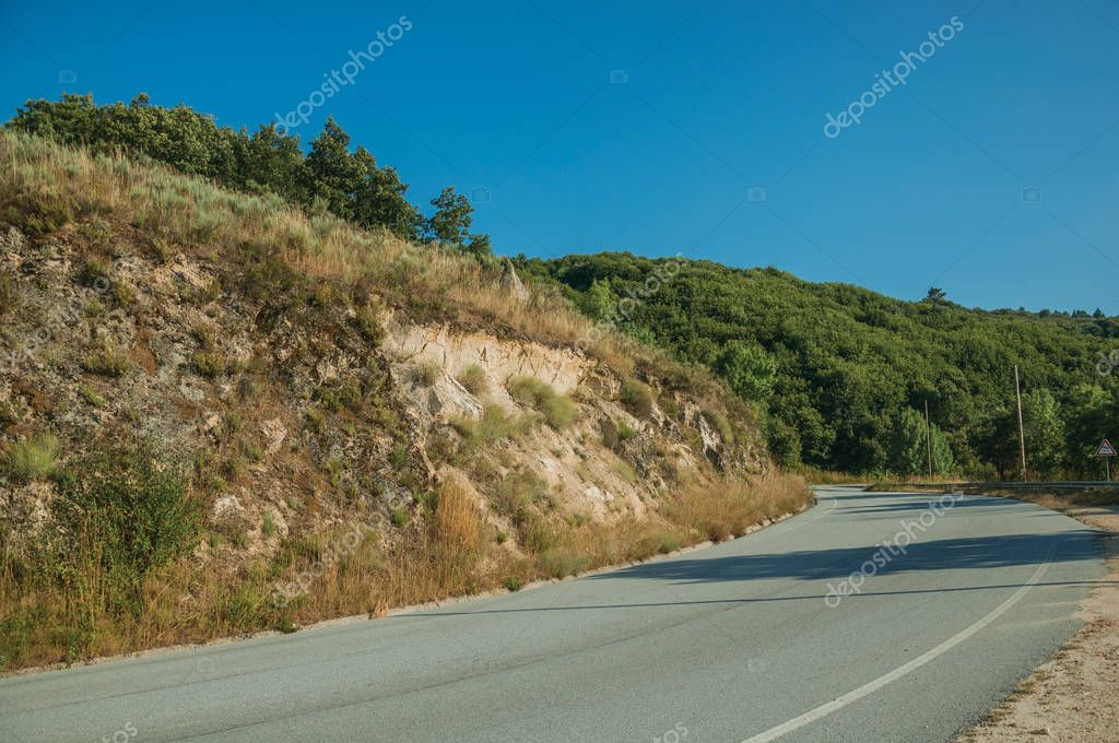 Road passing through hilly landscape