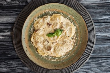 top view of gourmet italian ravioli with spinach and ricotta cheese on plate