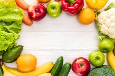 top view of fresh fruits and vegetables with copy space on wooden table