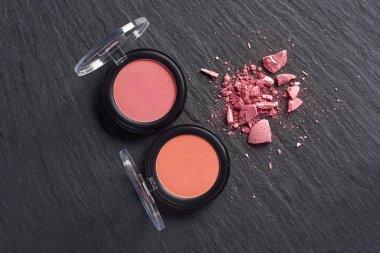 Broken blush by pressed blush on dark slate background stock vector