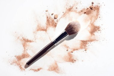 Plush makeup brush on white background with scattered face powder stock vector