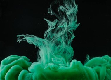 close-up view of green paint explosion on black background