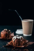 Fotografie Sweet chocolate muffins with cup of coffee on table