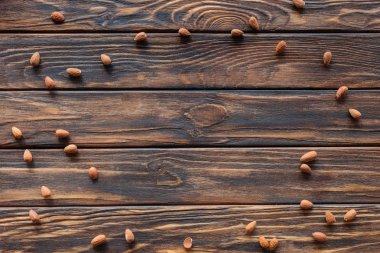 top view of arranged almonds on wooden surface