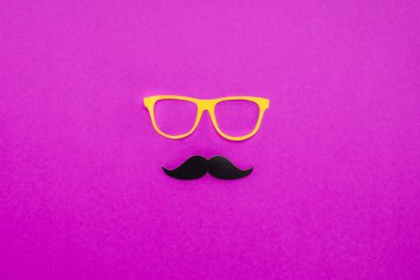top view of gentleman face made of cardboard eyeglasses and mustache on pink surface