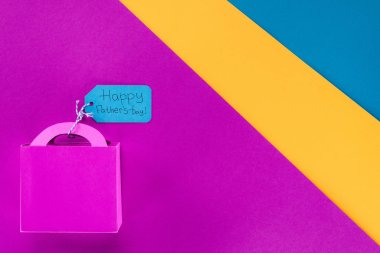 top view of gift box with Happy fathers day tag on colorful surface