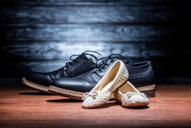close-up shot of leather father and daughter shoes on wooden surface, Happy fathers day concept
