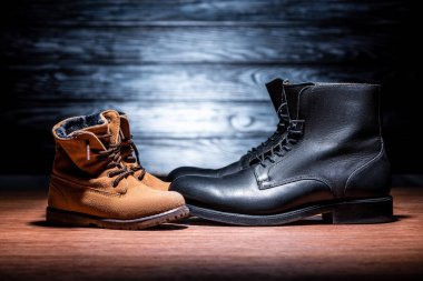 side view of father and son boots on wooden surface, Happy fathers day concept