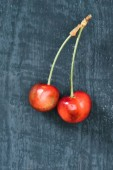 top view of tasty healthy sweet yellow cherries on rustic wooden surface
