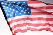 Photo close-up shot of waving united states flag on grey, Independence Day concept