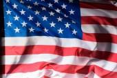közeli lövés a hullámzó Egyesült Államok zászló, a függetlenség napja koncepció