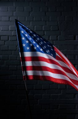 united states flag in front of black brick wall, Independence Day concept