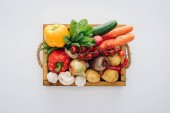 Fotografie top view of box with fresh organic vegetables isolated on white