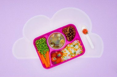 top view of tray with kids lunch for school on napkin isolated on violet