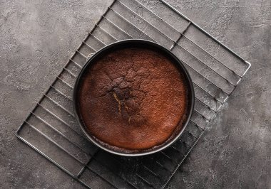 top view of delicious homemade brownie on grey surface
