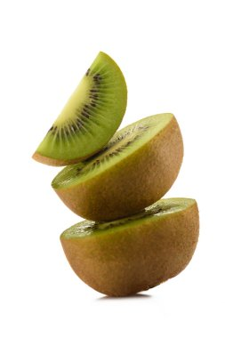close up view of fresh and ripe kiwi pieces isolated on white