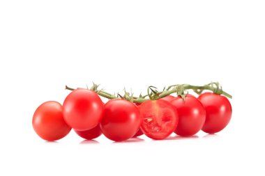 close up view of ripe cherry tomatoes on twig isolated on white