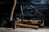 selective focus of vintage carpentry tools arranged on wooden tabletop