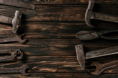 flat lay with arrangement of vintage carpentry tools on wooden tabletop