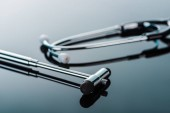 selective focus of reflex hammer and stethoscope on glass surface
