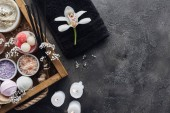 Fotografie top view of beautiful orchid, towel, burning candles and spa accessories on grey background