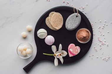 top view of various natural body care accessories on white, spa treatment concept