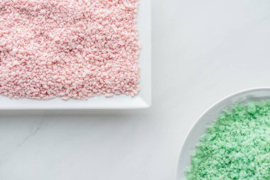 Top view of pink and green sea salt on white background stock vector