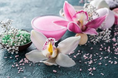 close-up view of beautiful orchids, small white flowers and sea salt, selective focus