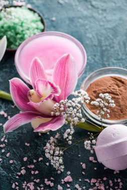beautiful tender flowers, homemade soap and lotion, spa treatment concept
