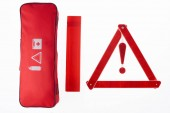 top view of red warning triangle and handbag isolated on white