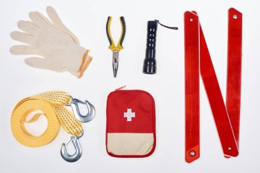 Flat lay with first aid kit and automotive accessories isolated on white stock vector