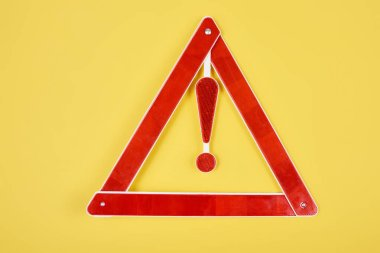 Top view of warning triangle road sign isolated on yellow stock vector