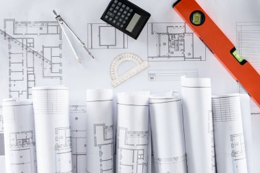 Top view of architect blueprints, ruler, protractor, calculator, divider and spirit level stock vector