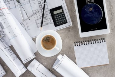Top view of architect workplace with coffee cup, blueprints, calculator and ipad tablet on table stock vector