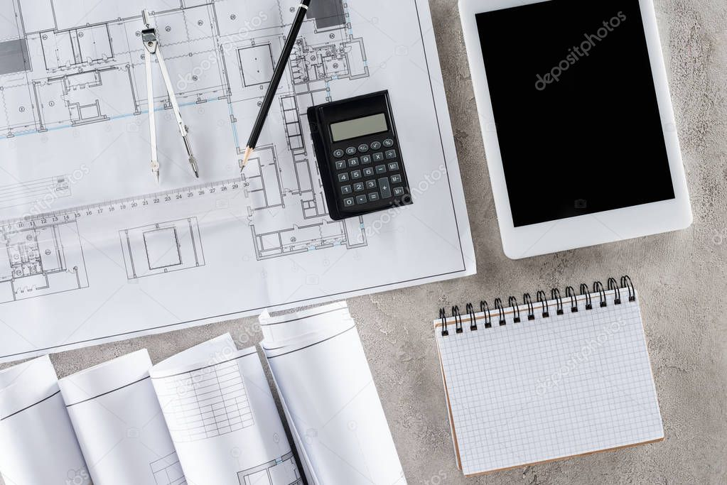 Top view of architect workplace with blueprint, divider and digital tablet with blank screen stock vector