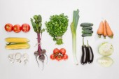 Fotografie flat lay with fresh autumn vegetables arranged isolated on white