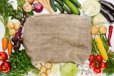 Food composition with ripe vegetables arranged around sackcloth isolated on white stock vector