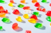 Photo tasty bright jelly candies on white surface