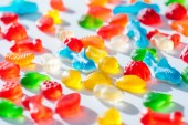 Photo different colored jelly candies on white surface