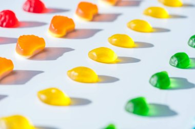 collection of sweet colored jelly candies on white