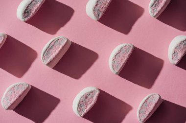 set of tasty marshmallows with shadows on pink