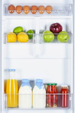 apples, lemons, juice and milk in fridge
