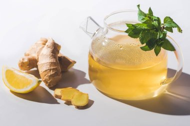 healthy tea with lemon and mint on white tabletop