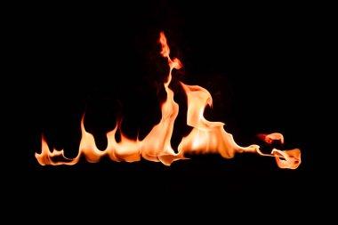 close up view of burning orange flame on black background