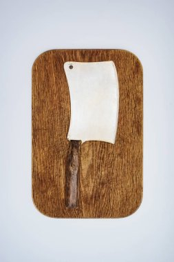 top view of meat knife on wooden chopping board isolated on grey