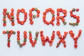 Fotografie top view of part of alphabet letters made of fresh sliced strawberries on white surface