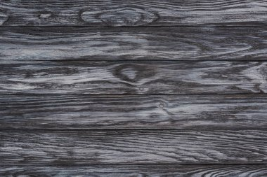 close-up view of dark wooden background with horizontal planks